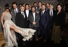 """Cast and crew members pose for photographers at the premiere of the film """"The Hobbit: The Desolation of Smaug"""" in Los Angeles December 2, 2013. REUTERS/Phil McCarten"""