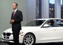 Dr. Herbert Diess, of the BMW Board of Management, speaks next to a 320i model at the North American International Auto Show in Detroit, Michigan January 14, 2013. REUTERS/James Fassinger
