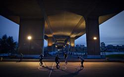 A group of youths play hockey on unicycles in Vancouver, British Columbia October 3, 2013. REUTERS/Andy Clark
