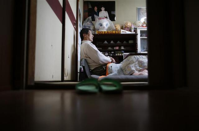 Seiji Sasa, a 67-year-old former professional wrestling promoter, speaks during an interview with Reuters at his home in Sendai, northern Japan December 18, 2013. REUTERS/Issei Kato