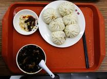 A serving of food which according to restaurant staff, is similar to what Chinese President Xi Jinping ate when he visited on Saturday, is pictured on a table after it was ordered by a diner at the Qing-Feng steamed buns restaurant in Beijing, December 29, 2013. REUTERS/Kim Kyung-Hoon
