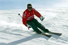 Then Ferrari's Michael Schumacher skis during a stay in the northern Italian resort of Madonna Di Campiglio in this January 16, 2004 file photo. REUTERS/Pool