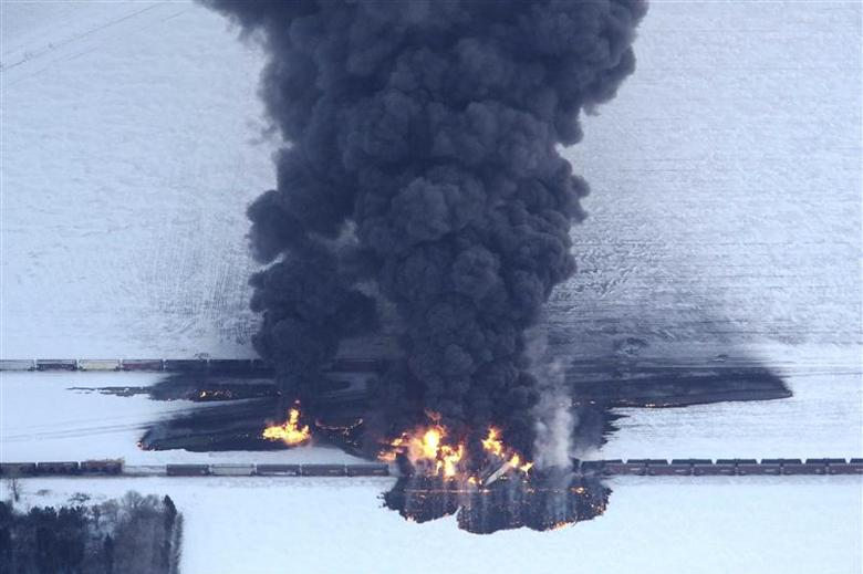 Smoke rises from scene of a derailed train near Casselton, North Dakota December 30, 2013. REUTERS/Michael Vosburg/Forum News Service