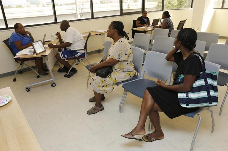 Visitors wait to speak with Certified Application Counselors about Affordable Care Act insurance, known as Obamacare, at the Borinquen Medical Center in Miami, Florida October 2, 2013. REUTERS/Joe Skipper