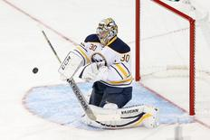 Buffalo Sabres goalie Ryan Miller (30) deflects the puck during the first period against the New York Rangers at Madison Square Garden. Mandatory Credit: Anthony Gruppuso-USA TODAY Sports