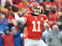 Dec 22, 2013; Kansas City, MO, USA; Kansas City Chiefs quarterback Alex Smith (11) throws a pass during the first half of the game against the Indianapolis Colts at Arrowhead Stadium. Denny Medley-USA TODAY Sports