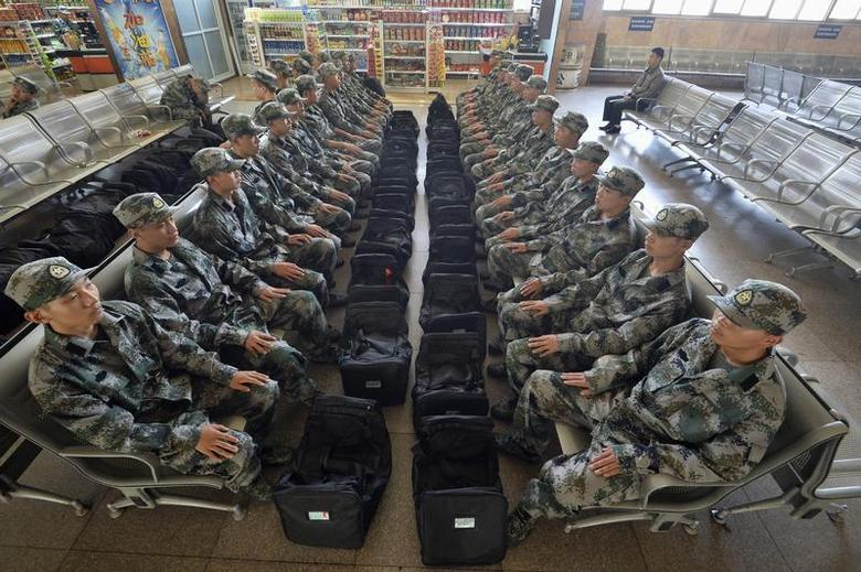 New recruits of China's People Liberation Army (PLA) soldiers sit at the waiting area of a railway station in Taiyuan, Shanxi province, September 10, 2013. REUTERS/Stringer