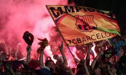 Le FC Barcelone est devenu le premier club de la planète football à franchir la barre symbolique des 50 millions d'amis sur le réseau social Facebook. /Photo d'archives/REUTERS/Albert Gea