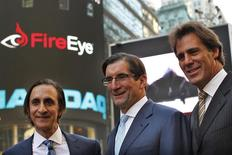FireEye Inc. Chairman of the Board, David DeWalt (R) and Founder Ashar Aziz (L) pose with Nasdaq CEO Robert Greifeld outside the Nasdaq Market site in Times Square following the company's debut on the Nasdaq exchange in New York, September 20, 2013. REUTERS/Brendan McDermid