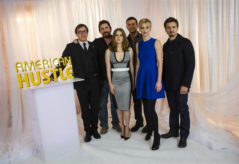 ''American Hustle'' director David O. Russell poses for a portrait with cast members Christian Bale, Amy Adams, Bradley Cooper, Jennifer Lawrence and Jeremy Renner in New York December 8, 2013. REUTERS/Eric Thayer/Files