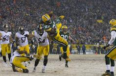 Green Bay Packers running back Eddie Lacy (27) leaps for a touchdown during the first quarter against the Pittsburgh Steelers at Lambeau Field. Jeff Hanisch-USA TODAY Sports
