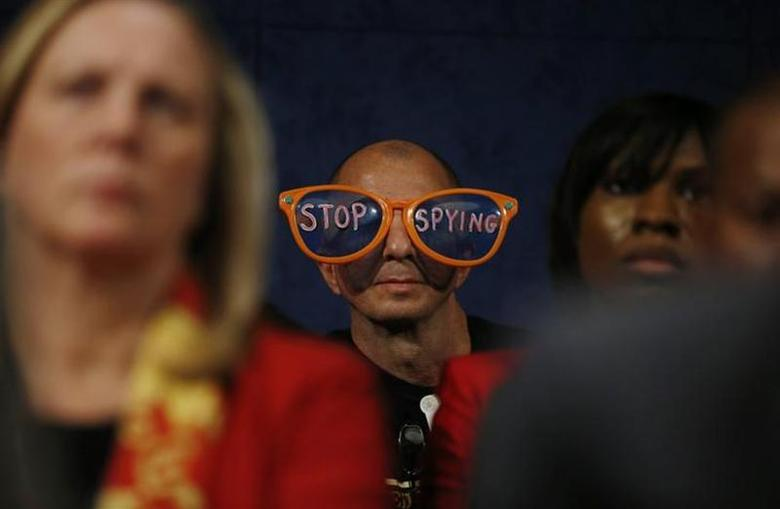 A protester against the practices of U.S. security agenices sits in the audience as U.S. Director of National Intelligence James Clapper, Deputy Attorney General James Cole and General Keith Alexander, director of the National Security Agency (not pictured) testify at a House Intelligence Committee hearing on Capitol Hill in Washington, October 29, 2013. REUTERS/Jason Reed/Files