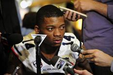 January 4, 2014; Newport Beach, CA, USA; Auburn Tigers quarterback Nick Marshall (14) speaks with media at the Newport Beach Marriott. Mandatory Credit: Gary A. Vasquez-USA TODAY Sports