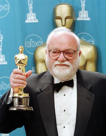 Saul Zaentz, producer of ''The English Patient,'' holds on to his Oscar for Best Picture, backstage during the 69th annual Academy Awards in this March 24, 1997 file photo. REUTERS/Blake Sell/Files