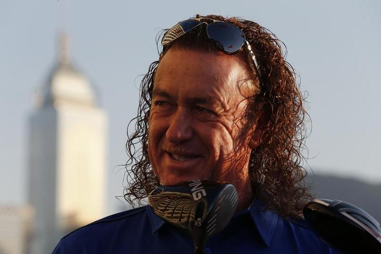 Spain's Miguel Angel Jimenez poses after being selected as the playing captain for Team Europe for the inaugural EurAsia Cup, at a news conference in Hong Kong December 2, 2013. REUTERS/Bobby Yip