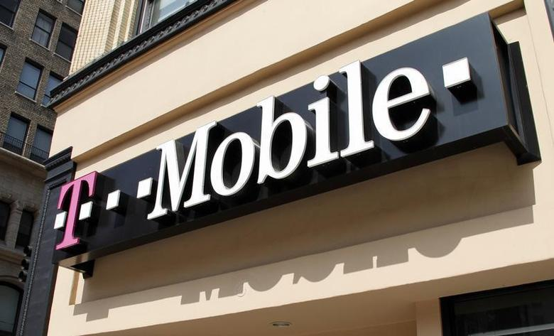Signage for a T-Mobile store is pictured in downtown Los Angeles, California August 31, 2011. REUTERS/Fred Prouser