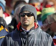 Golfer Tiger Woods of the U.S. watches the Women's World Cup Downhill skiing race in Val d'Isere, French Alps, December 21, 2013. REUTERS/Robert Pratta