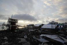 A damaged fishing boat is seen in a devastated area of Magallanes town, Tacloban city, central Philippines December 24, 2013. REUTERS/Romeo Ranoco