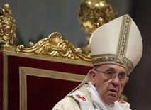 Pope Francis looks on as he leads the Epiphany mass in Saint Peter's Basilica at the Vatican January 6, 2014. REUTERS/Max Rossi