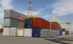 A truck is loaded with a container at the Port of Montreal, September 27, 2010. REUTERS/Shaun Best