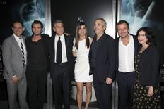 From L to R: President, Creative Development and Worldwide Production, Warner Bros. Pictures, Greg Silverman, screenwriter Jonas Cuaron, actors George Clooney and Sandra Bullock, director Alfonso Cuaron, producer David Heyman and Warner Bros. President of Worldwide Marketing and International Distribution, Sue Kroll arrive for the New York premiere of 'GRAVITY' October 1, 2013. REUTERS/Andrew Kelly