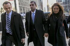 Former SAC Capital portfolio manager Mathew Martoma (C) arrives at the Manhattan Federal Courthouse with his lawyer (L) and an unidentified woman in New York, January 7, 2014. REUTERS/Brendan McDermid