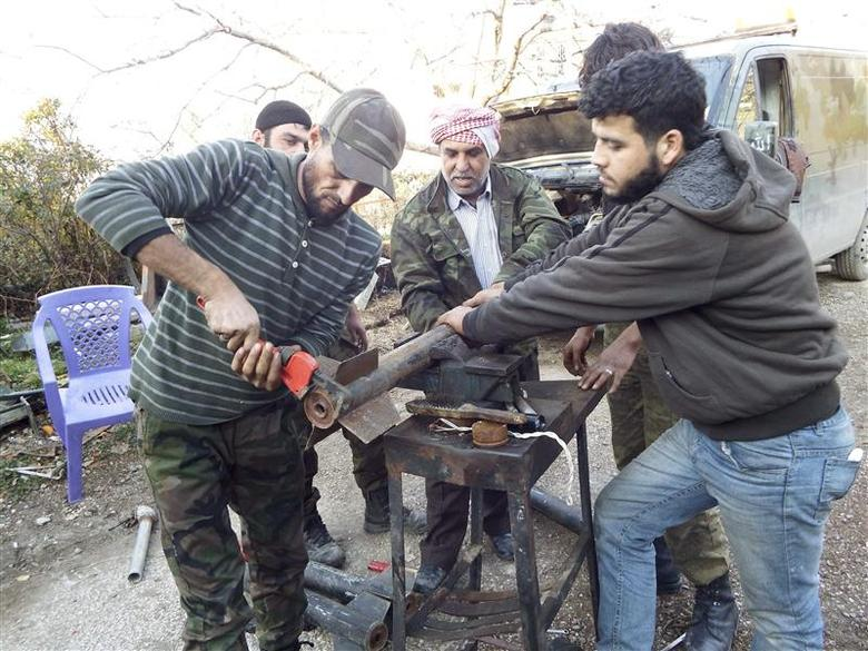 Free Syrian Army fighters prepare homemade rockets in Latakia countryside January 7, 2014. REUTERS/Khattab Abdulaa