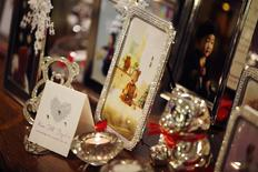 Frames of Kim Dot-byul's pictures are displayed during her first birthday party or Doljanchi in Korean in Seoul December 14, 2013. REUTERS/Kim Hong-Ji
