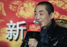 """Chinese director Zhang Yimou answers a question during a news conference for his new movie """"the 13 Women of Nanjing"""" (the city also known as Jinling), in Beijing, December 22, 2010. REUTERS/Barry Huang"""