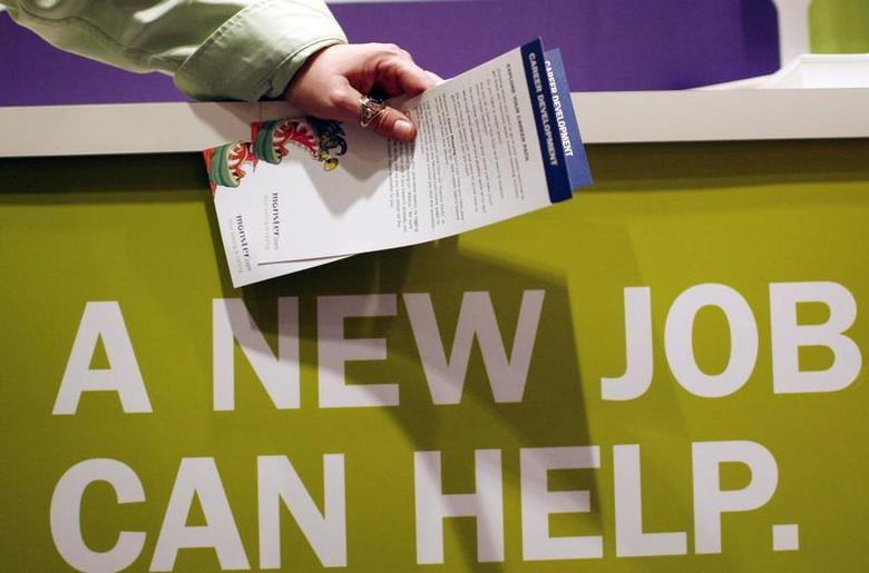 A man holds pamphlets as he waits at a job fair sponsored by employment website Monster.com as part of their ''Keep America Working'' tour at a hotel in New York's Times Square, March 5, 2009. REUTERS/Mike Segar