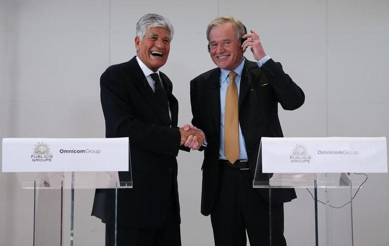 Maurice Levy (L) , French advertising group Publicis Chief executive, and John Wren, head of Omnicom Group react during a joint news conference in Paris, July 28, 2013. REUTERS/Christian Hartmann