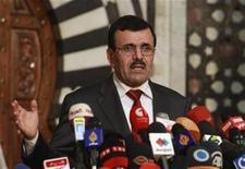 رئيس الحكومة المؤقتة في تونس علي العريض اثناء مؤتمر صحفي في تونس يوم 23 اكتوبر تشرين الأول 2013 - رويترز
