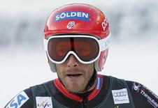 Bode Miller of the U.S. reacts after crossing the finish line during the men's World Cup Downhill skiing race in Val Gardena December 21, 2013. REUTERS/Max Rossi