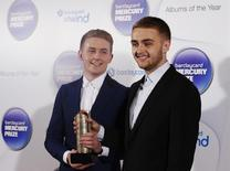Musicians Howard (L) and Guy Lawrence of the British electronic band Disclosure, nominated for the Mercury Music Prize, poses for a photograph ahead of the ceremony in north London, October 30, 2013. REUTERS/Olivia Harris