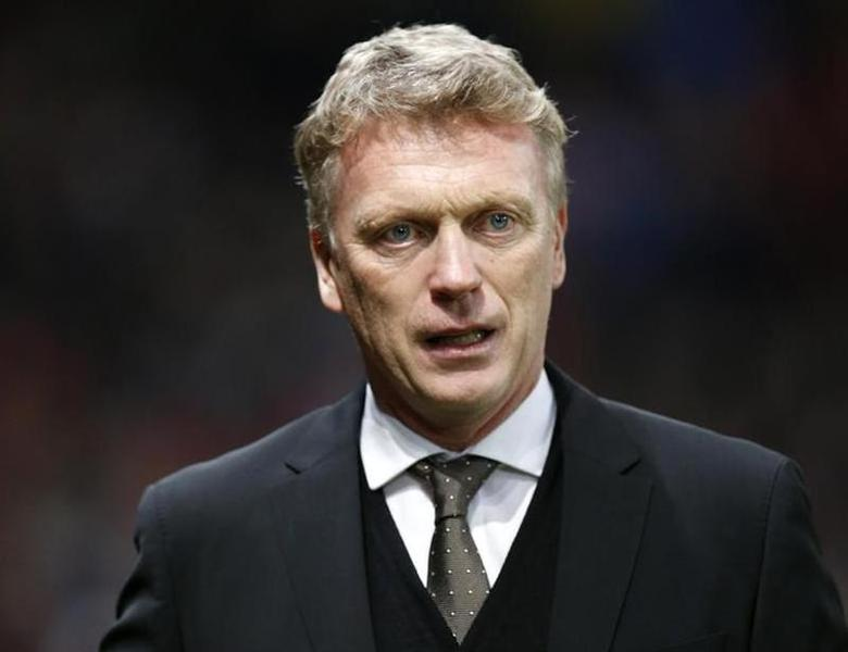 Manchester United manager David Moyes attends their English FA Cup soccer match against Swansea City at Old Trafford in Manchester, northern England January 5, 2014. REUTERS/Russell Cheyne
