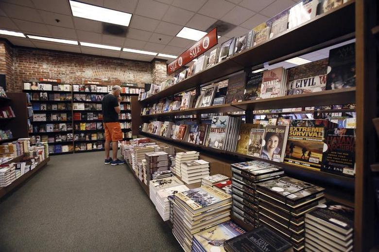 A patron looks at books at a Barnes & Noble bookstore in Pasadena, California November 26, 2013. REUTERS/Mario Anzuoni