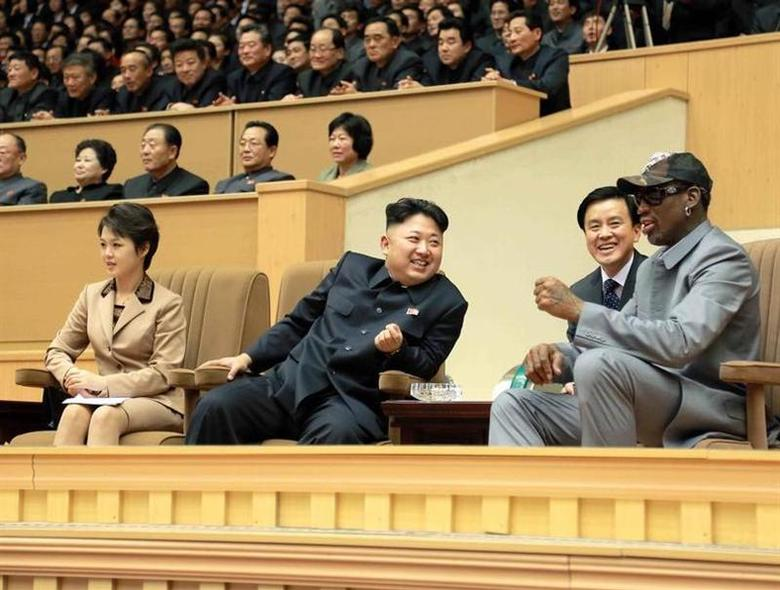 North Korean leader Kim Jong Un (2nd L) watches a basketball game between former U.S. NBA basketball players and North Korean players of the Hwaebul team of the DPRK with Dennis Rodman (R) at Pyongyang Indoor Stadium in this undated photo released by North Korea's Korean Central News Agency (KCNA) in Pyongyang January 9, 2014. REUTERS/KCNA