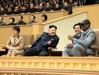 North Korean leader Kim Jong Un (2nd L) watches a basketball game between former U.S. REUTERS/KCNA