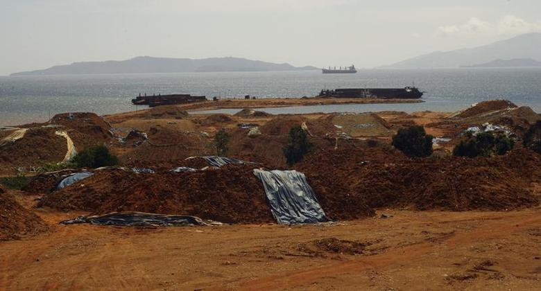 Stockpiles of nickel ore are seen awaiting shipment to the port in Pomala, Southeast Sulawesi province September 2, 2012. REUTERS/Yusuf Ahmad
