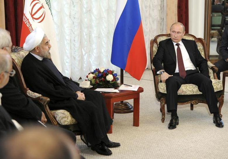 Russia's President Vladimir Putin (R) meets with his Iranian counterpart Hassan Rouhani during the Shanghai Cooperation Organization (SCO) summit in Bishkek, September 13, 2013. REUTERS/Mikhail Klimentyev/RIA Novosti/Kremlin