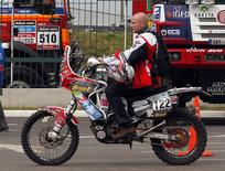 Belgium's Eric Palante rides his Honda for a technical verification exercise of the sixth South American edition of the Dakar Rally 2014, in Rosario January 3, 2014. REUTERS/Enrique Marcarian