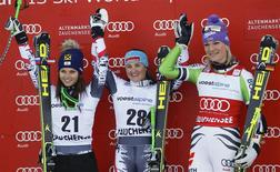 Anna Fenninger and Elisabeth Goergl of Austria and Germany's Riesch (LtoR) stand on the podium after the World Cup Women's Downhill race in Altenmarkt-Zauchensee January 11, 2014. REUTERS/Leonhard Foeger