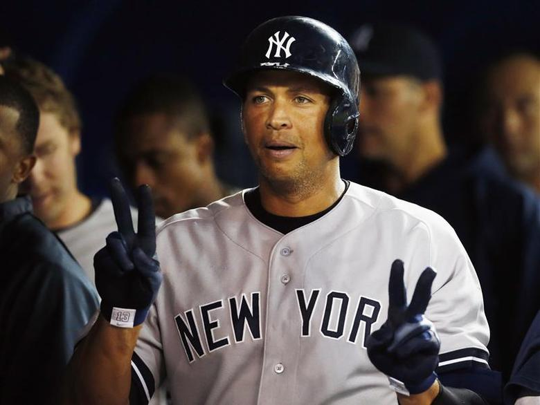 New York Yankees Alex Rodriguez celebrates his home run against the Toronto Blue Jays during the fifth inning of their MLB American League baseball game in Toronto in this August 26, 2013 file photo. REUTERS/Mark Blinch/Files