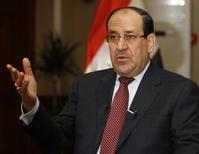 O primeiro-ministro iraquiano, Nuri al-Maliki, fala durante uma entrevista à Reuters, em Bagdá. Maliki ameaçou neste domingo cortar a fatia do Curdistão do orçamento federal se a região autônoma exportar petróleo à Turquia via um novo oleoduto sem o consentimento do governo central.12/01/2014 REUTERS/Thaier Al-Sudani