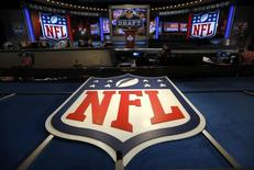 The NFL logo and set are seen at New York's Radio City Music Hall before the start of the 2013 NFL Draft April 25, 2013 file photo. REUTERS/Shannon Stapleton