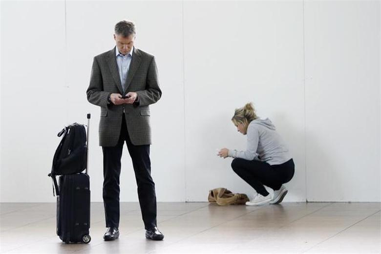 Passengers wait in the departure hall of Zaventem international airport near Brussels November 19, 2013. REUTERS/Francois Lenoir/Files