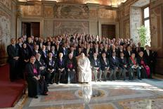 Pope Francis (C) poses during an audience with the diplomatic corps at the Vatican January 13, 2014. REUTERS/Osservatore Romano
