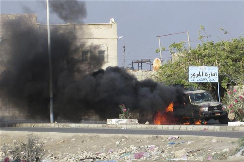 Smoke billows from a military truck set on fire during an attack by gunmen on a military post in al-Shihr city of the southeastern Yemeni province of Hadramout January 12, 2014. REUTERS/Stringer