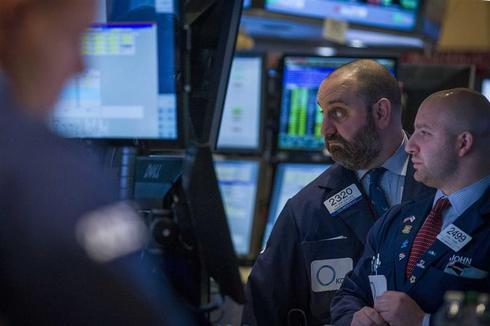 Wall Street slides on caution ahead of earnings