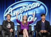 """Judges Keith Urban (L), Jennifer Lopez (C), and Harry Connick, Jr. of """"American Idol"""" take part in Fox Broadcasting Company's part of the Television Critics Association (TCA) Winter 2014 presentations in Pasadena, California, January 13 , 2014. REUTERS/Kevork Djansezian"""